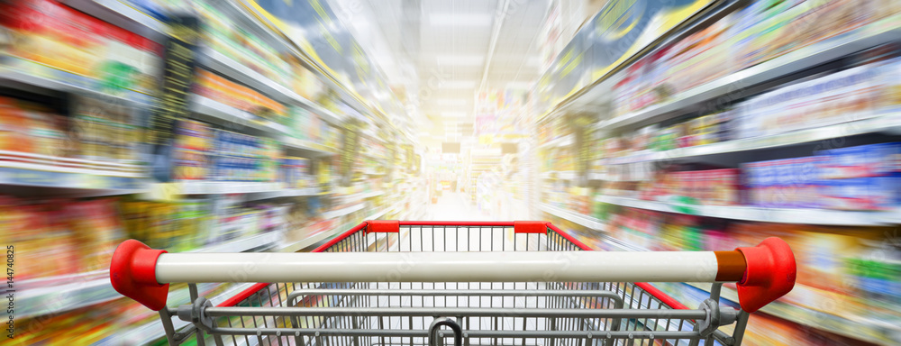 Fototapety, obrazy: Supermarket aisle with empty red shopping cart