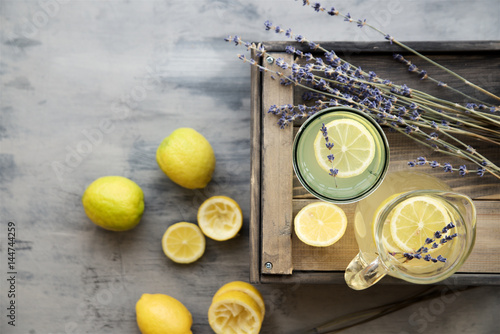 Photo  Lemonade with lemons and lavender on gray  shabby table