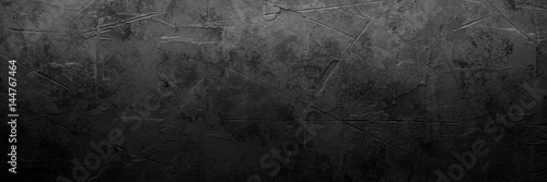 Black empty concrete stone texture. Slate background. Long banner format.