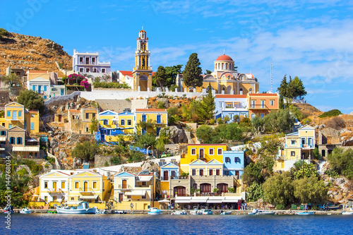 Tuinposter Barcelona Perfect sunny day and beautiful view from the sea on colorful houses on rocks on Greek island Simi Symi , Dodecanesse