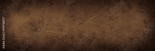 Brown empty concrete stone texture. Slate background. Long banner format.