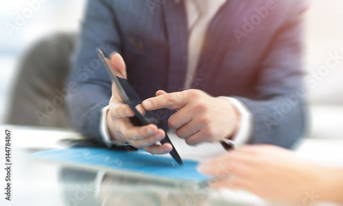 Fototapety, obrazy: Business man working at office with laptop, tablet and graph data documents
