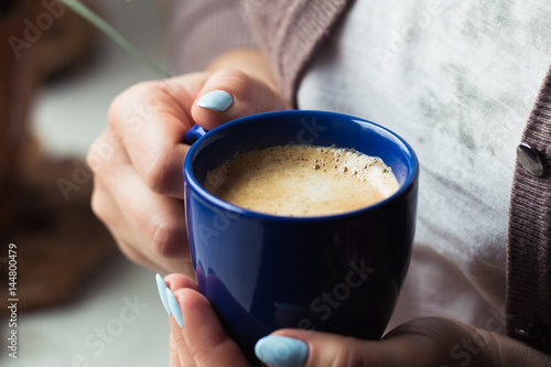 Garden Poster Tea Girl with blue manicure holds a blue cup of coffee