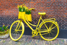 Vintage Yellow Bicycle With Ba...