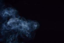 White Smoke In Black Background.