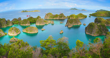 Raja Ampat Marine Park, Blue Lagoon Next To Painemo Island Among Small Islands, In West Papua, Indonesia, Asia. Horizontal Panoramic View