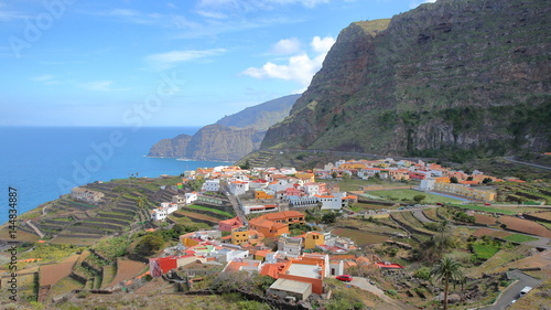 AGULO, LA GOMERA, SPAIN: General view of the village with terraced fields and cliffs in the background