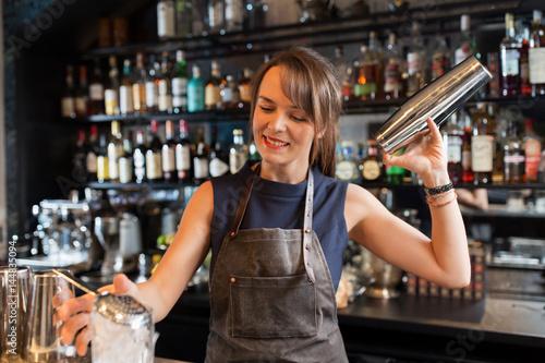 barmaid with shaker preparing cocktail at bar Canvas-taulu
