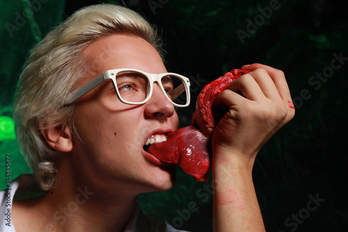 crazy hungry doctor with fresh raw meat and table with chemical flasks Fototapet