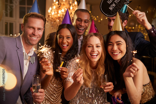 Photo  Group Of Friends Celebrating At New Year Party Together