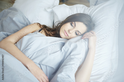 Close up of sleeping woman in her bed