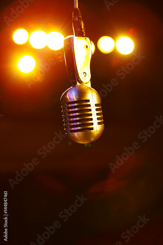 Retro Shure microphone in the stage lights Fototapeta