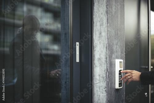 Businessman entering security code to open office door