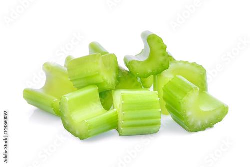 chopped celery sticks isolated on white background