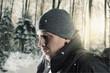 canvas print picture Erschöpfter Wanderer ausser Puste vor Winterwald