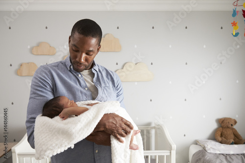 Father Holding Newborn Baby Son In Nursery Canvas Print