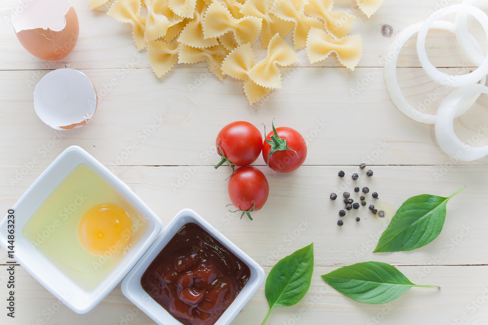Stampe  spaghetti with ingredients for cooking on wood background