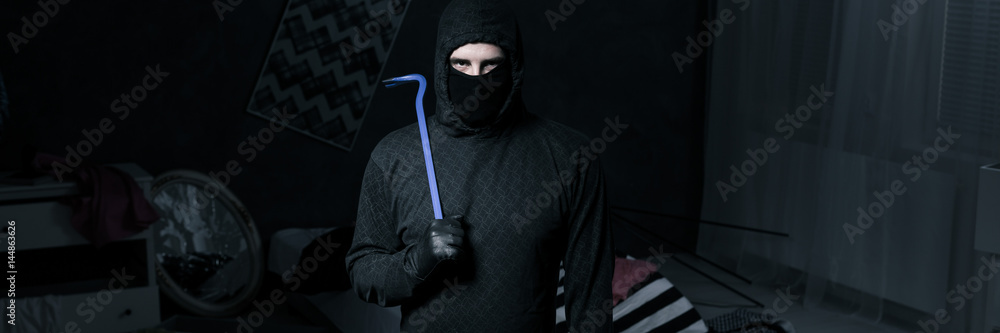 Fototapeta Burglar in apartment