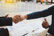 businessman handshaking and show a thumb up after meeting in office - teamwork, cooperation, agreement, acquisition concept