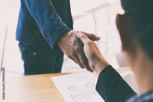 businessman handshaking after meeting in office - teamwork, cooperation, agreeme Canvas Print