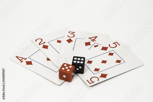 фотография  Red and white playing cards and a pair of black and red dice on a white background
