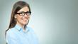 Leinwanddruck Bild - Young smiling modern business woman wearing glasses