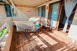 Adorable little girls on terrace during of cozy room summer vacation