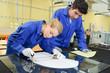 Leinwanddruck Bild - young metallurgists at work in school workshop