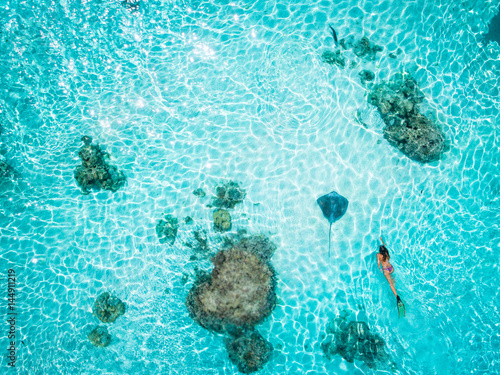 Woman snorkeling with stingray, Tahiti, French Polynesia