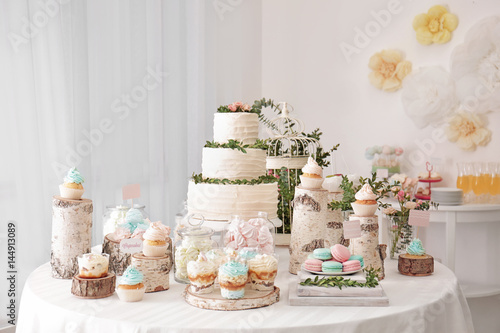 Door stickers Macarons Candy bar. Table with different sweets for party