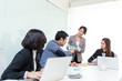 Group of business people discuss in meeting room