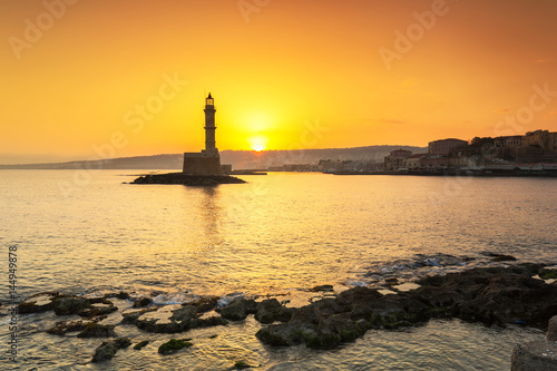 Lighthouse of the old Venetian port in Chania at sunrise, Crete. Greece