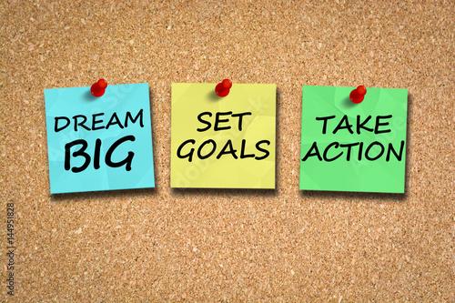 Dream big, set goals, take action, success recipe on cork billboard