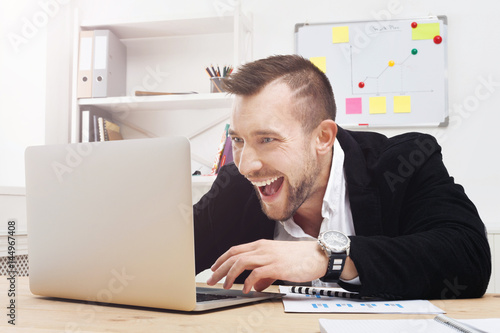 Young businessman gambling and gaming in the office Poster