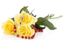 Silver Crucifix And Yellow Roses