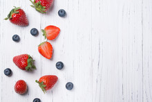 Food Background With Fresh Strawberry And Blueberry Pattern Frame, Top View Wooden Table