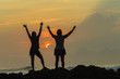 Girls Holiday Expressions Silhouetted Beach Sunrise Ocean