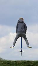 Boy On Pogo Stick