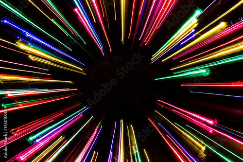 Colorful neon light lines on black background.