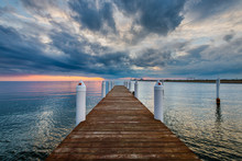 Hemingway Pier Next To The Bay Bridge Outside Of Annapolis Maryland At Sunset
