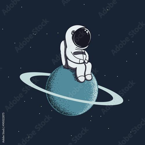 astronauta-siedzacy-na-planecie-na-tle-nieba
