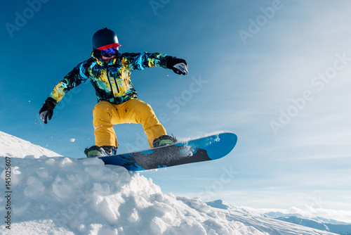 snowboarder is jumping in the sun beam