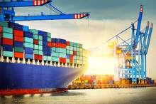 Container Ship With Full Of Cargo Entering A Port. Transportation Background