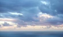 Scenic Cloud Sky Over Ocean Background