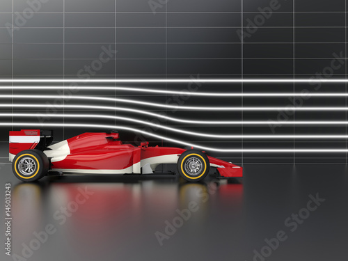 Red fast formula racing car in wind tunnel