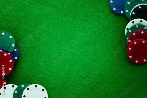 Photo  Green felt and playing chips abstract background.