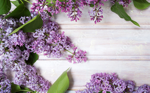 Fotobehang Lilac Fresh lilac flowers on a wooden table