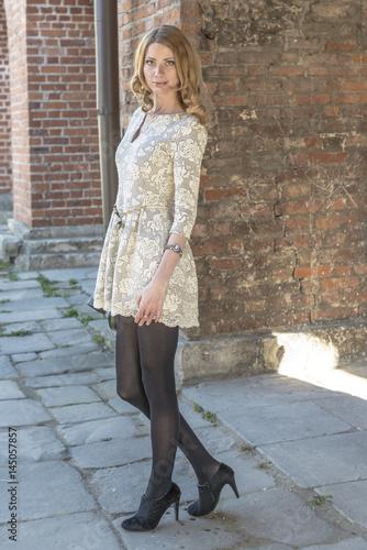 Spoed Foto op Canvas Gypsy Blonde girl in lace dress in an old fortress