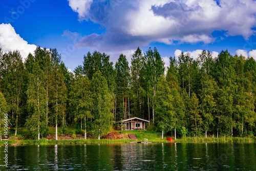 Poster Meer / Vijver Wooden sauna log cabin at the lake in summer in Finland