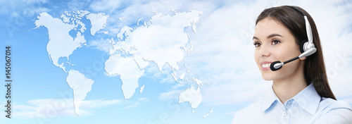contact us, customer service operator woman with headset smiling isolated on international map background